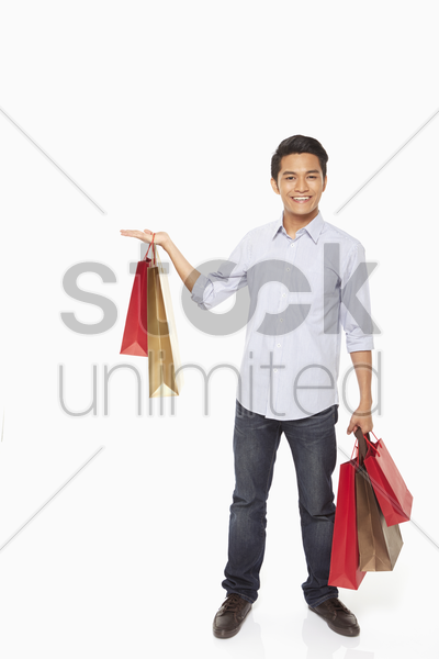 man with shopping bags showing hand gesture stock photo