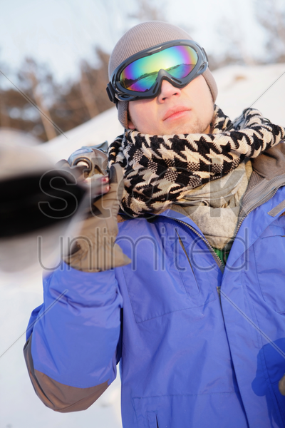 man with ski equipment stock photo