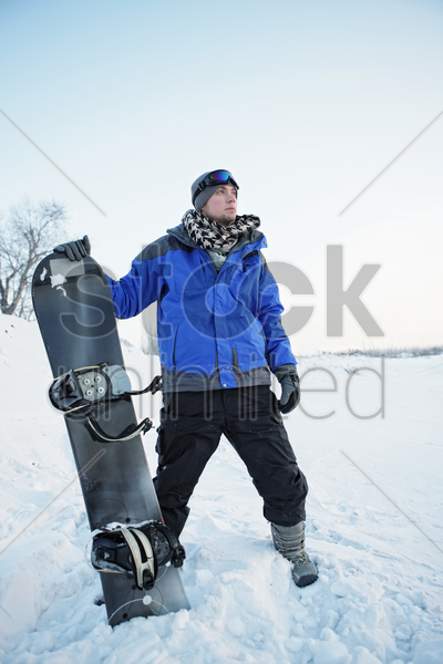 man with snowboard stock photo