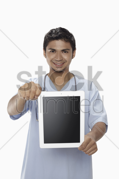 man with stethoscope showing digital tablet stock photo