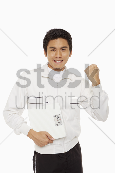 man with weight scale cheering stock photo