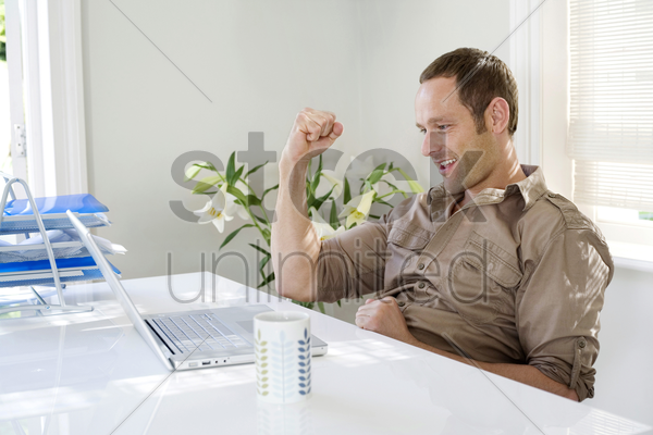 man working in a home office stock photo