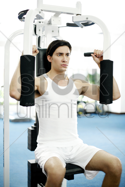 man working out in the gymnasium stock photo