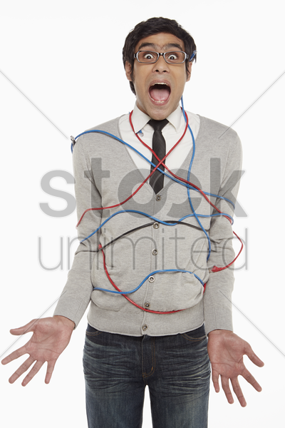 man wrapped in network cables stock photo