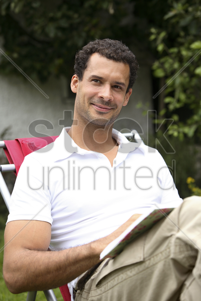 man writing in his diary stock photo