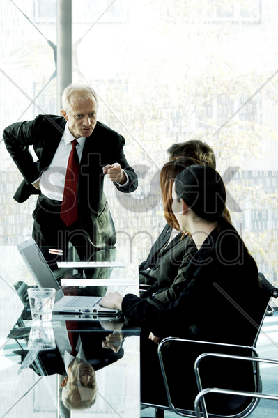 manager scolding his subordinates stock photo