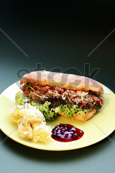 meat salad sandwich with mashed potatoes and cranberry sauce stock photo