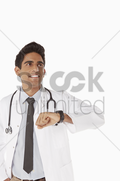 medical personnel checking his watch stock photo