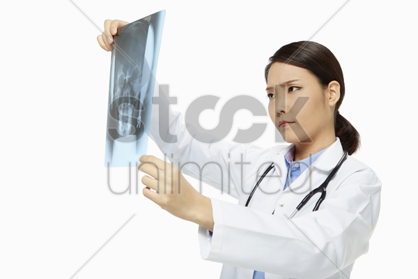 medical personnel checking up on an x-ray film stock photo