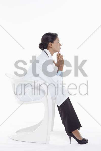 medical personnel contemplating stock photo