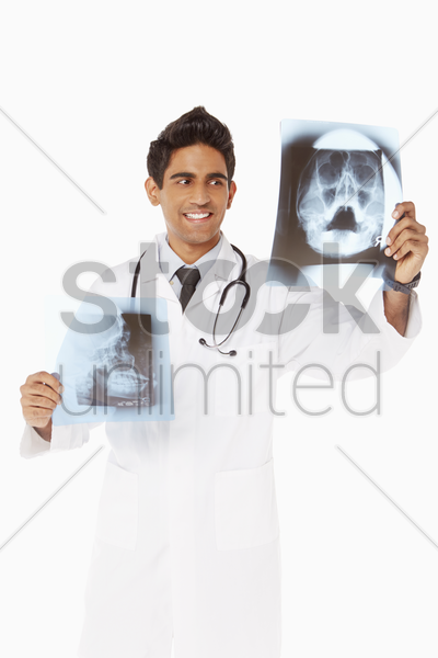medical personnel examine x-ray films stock photo