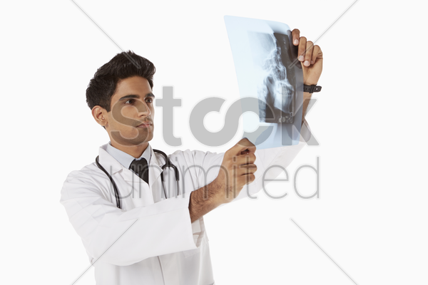 medical personnel examining an x-ray film stock photo
