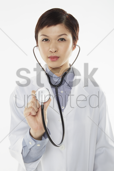 medical personnel examining with a stethoscope stock photo
