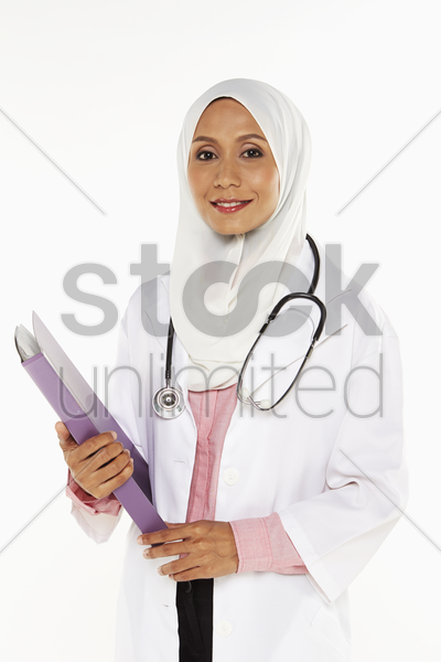 medical personnel holding a folder, smiling stock photo