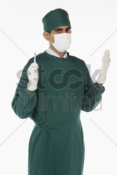 medical personnel holding a scalpel stock photo