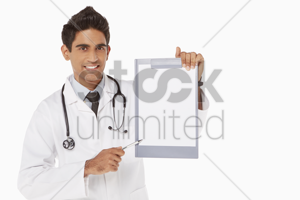 medical personnel holding up a blank clipboard stock photo