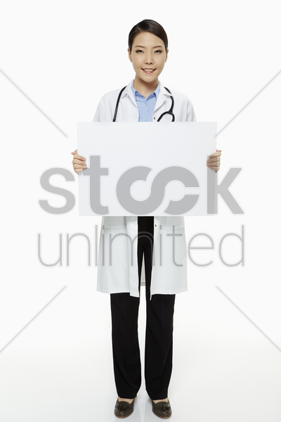 medical personnel holding up a blank placard stock photo