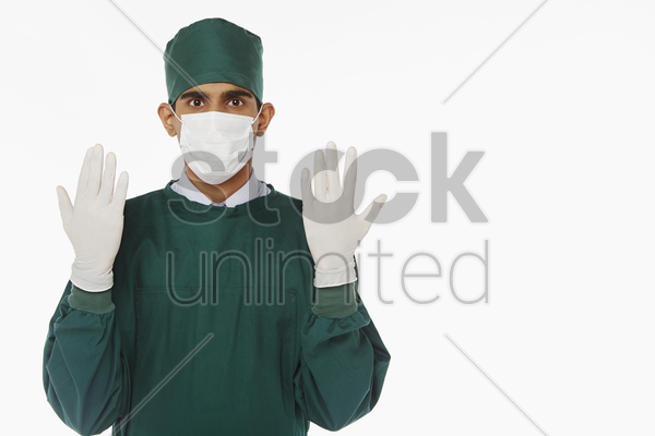 medical personnel in surgical gown stock photo