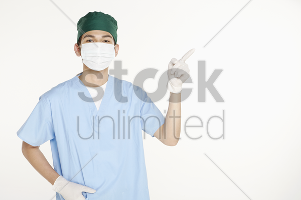 medical personnel pointing to the left stock photo