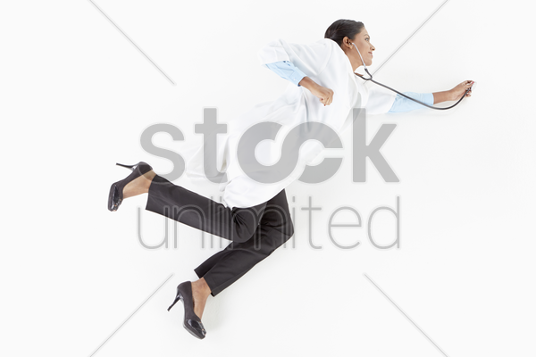 medical personnel posing on the floor with stethoscope stock photo