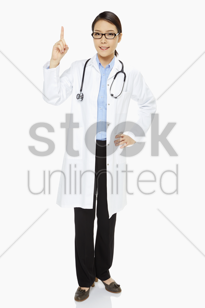 medical personnel showing hand gesture stock photo