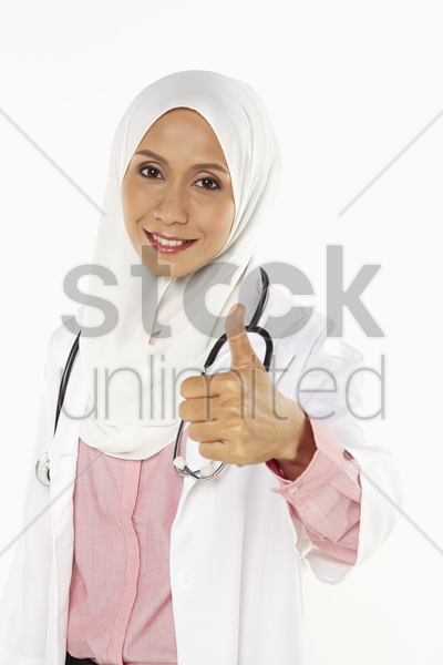 medical personnel showing thumbs up stock photo