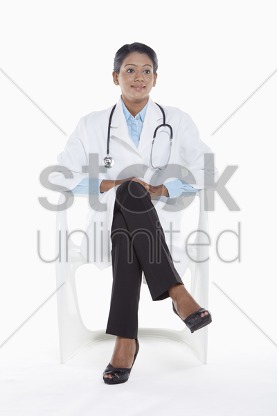 medical personnel sitting on a chair stock photo