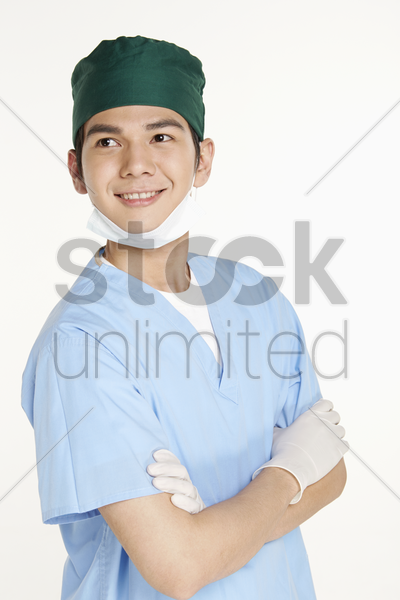 medical personnel smiling with arms crossed stock photo