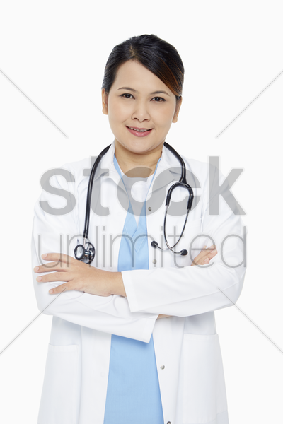 medical personnel standing with arms crossed, smiling stock photo
