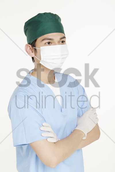 medical personnel standing with arms crossed stock photo