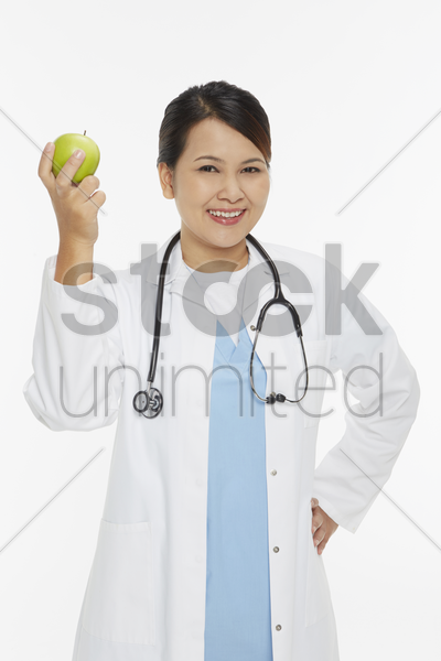medical personnel with a green apple in her hand stock photo