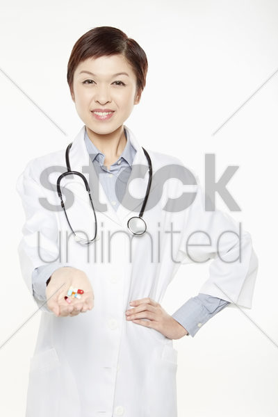 medical personnel with pills in her hand stock photo