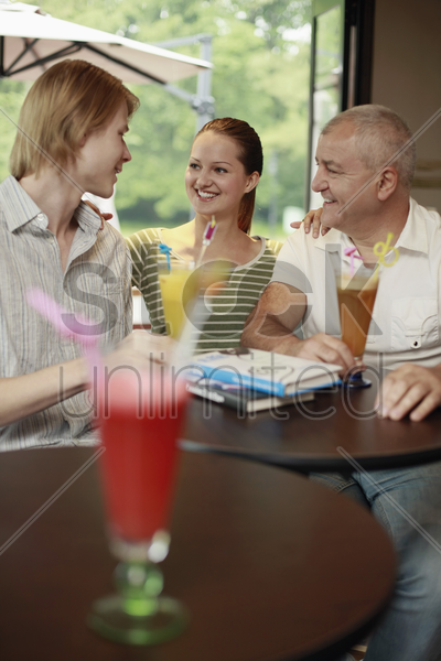 men and woman hanging out in the bar stock photo