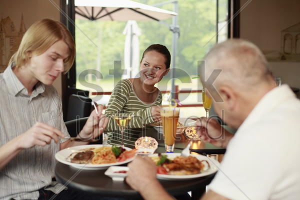 men and woman having lunch together stock photo
