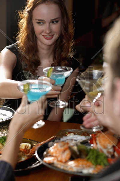 men and women toasting stock photo