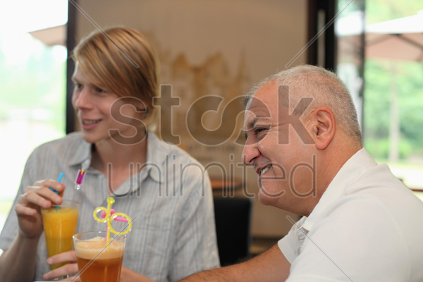 men having drinks in bar stock photo