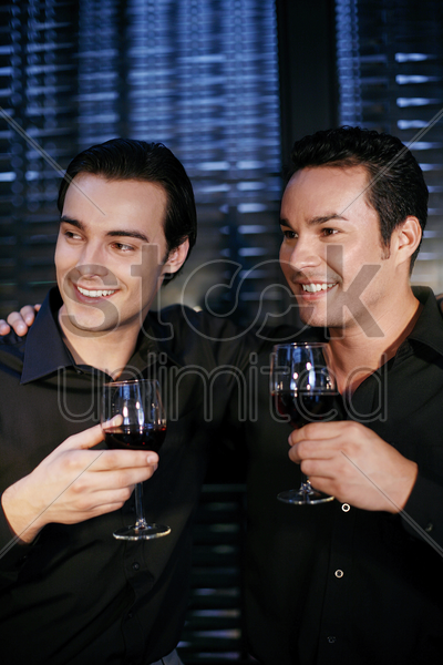 men holding glasses of wine stock photo