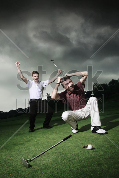 men playing golf at golf course stock photo