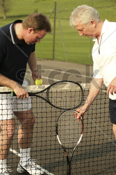 men with tennis racquet and ball stock photo