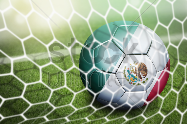 mexico soccer ball in goal net stock photo