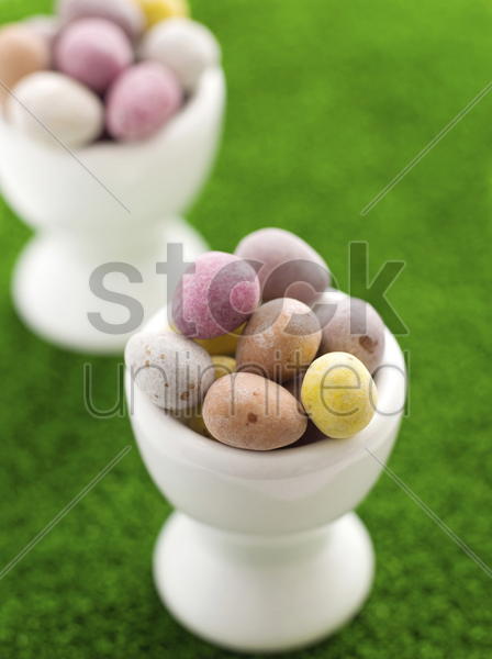 mini eggs in egg cups stock photo