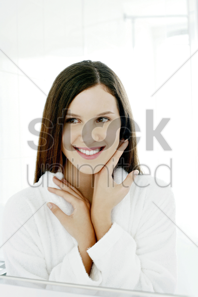 mirror reflection of woman checking her face in the mirror stock photo