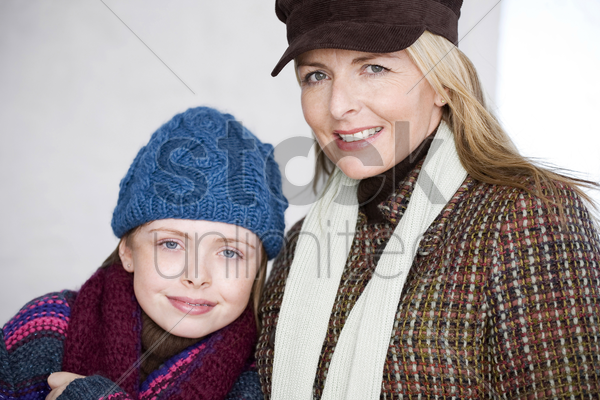 mother and daughter in winter clothing stock photo
