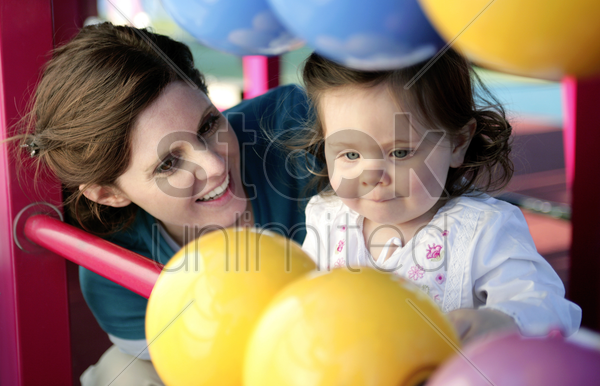 mother and daughter playing with abacus in the playground stock photo