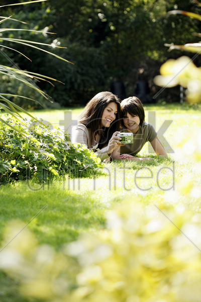 mother and daughter taking picture together stock photo