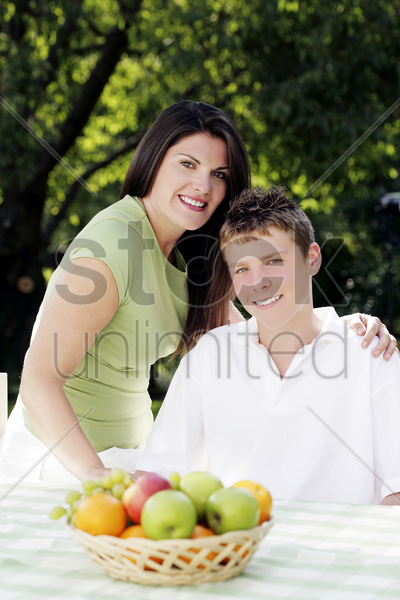 mother and son posing for the camera stock photo