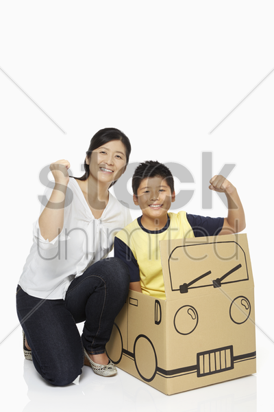 mother and son showing hand gesture stock photo