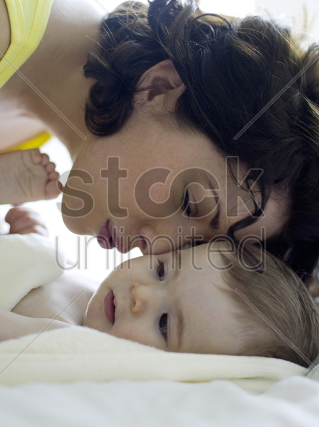 mother playing with baby girl stock photo