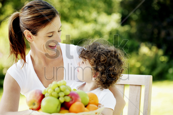 mother talking to her daughter stock photo