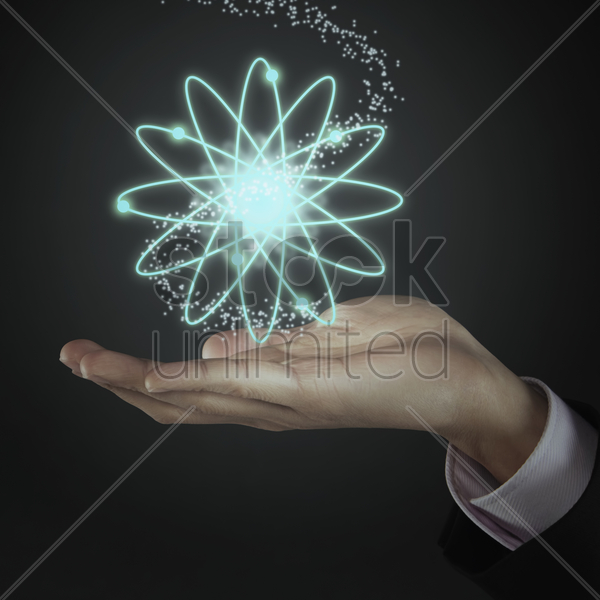 multiple orbit floating above human hand stock photo